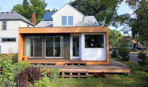 casa con pabellón de construcción sostenible con acceso al jardín