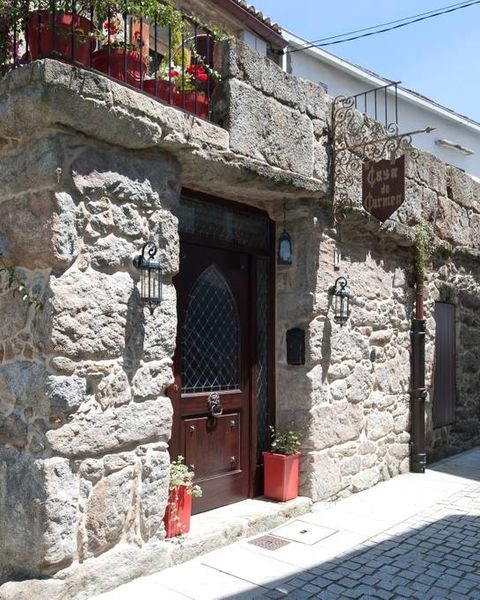 Property, Building, House, Facade, Architecture, Real estate, Village, Stone wall,
