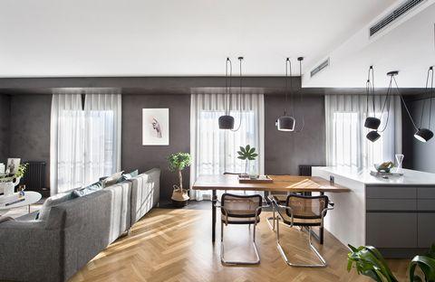 espacio con cocina y salón decorado en tonos grises