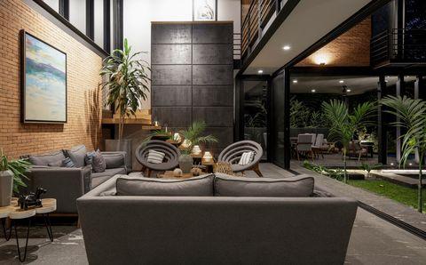 salón de estilo industrial abierto al jardín