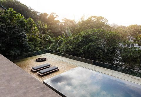 Swimming pool, Sunlight, Composite material, Courtyard, Outdoor furniture, Tile,