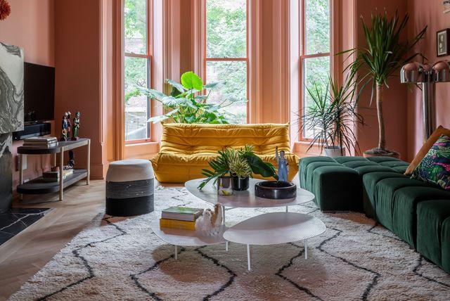 mkca diseña clinton hill brownstone, una casa llena de color en brooklyn con chimenea, patio trasero y una colección de arte divertida