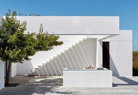 Wall, Shade, Concrete, Urban design, Composite material, Stairs, Rectangle, Shadow,