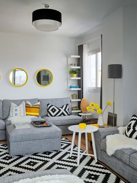 Living room, Room, Furniture, Interior design, Yellow, Property, Table, Coffee table, Couch, Wall,