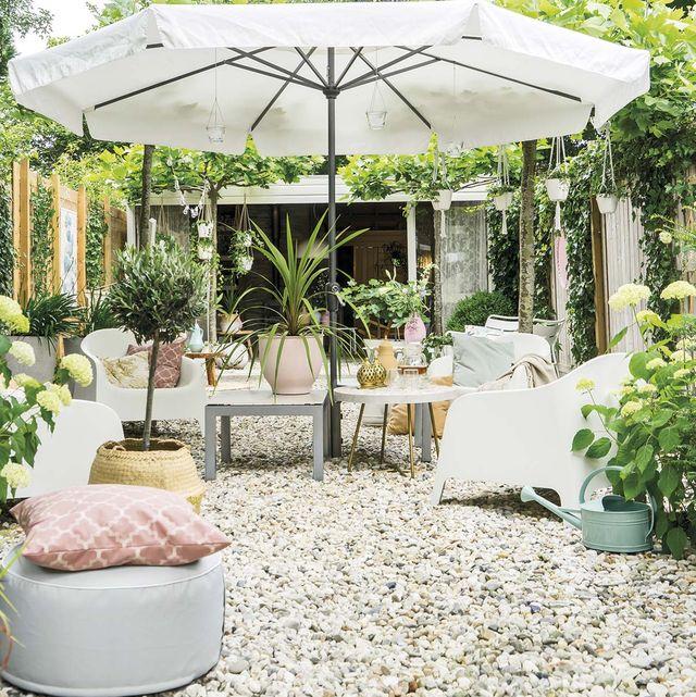 Una casa decorada en tonos pastel: Jardín y porche