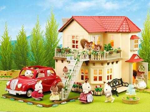 Casa de muñecas con figuritas de animales