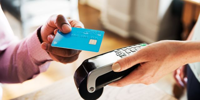 women tapping contactless instead of using cash