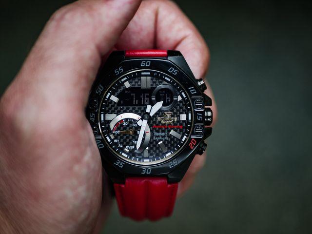honda x casio edifice 20th anniversary watch, naturally lit in someone's hand