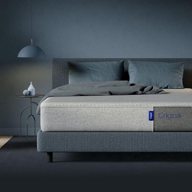 casper mattress on bed in a dark grayblue room