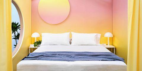 casper mattress bedding in pink and yellow room