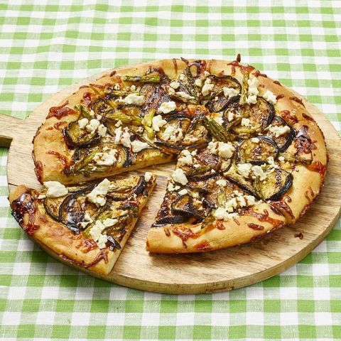roasted veggie cast iron pizza on wood board
