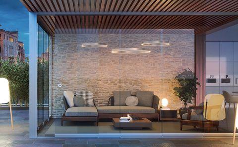 vista de un salón interior acristalado con cortinas de cristal del nuevo catálogo de cerramientos kauma