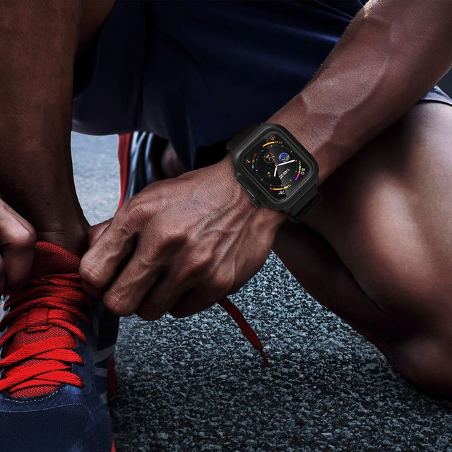 runner tying his shoes with catalyst apple watch case on his wrist