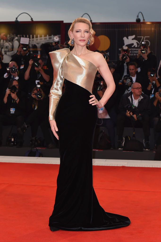 Blanchett practically shut down the red carpet in a stunning velvet and gold Armani Prive gown with an embellished asymmetrical bodice at the premiere of Suspiria at the Venice Film Festival.