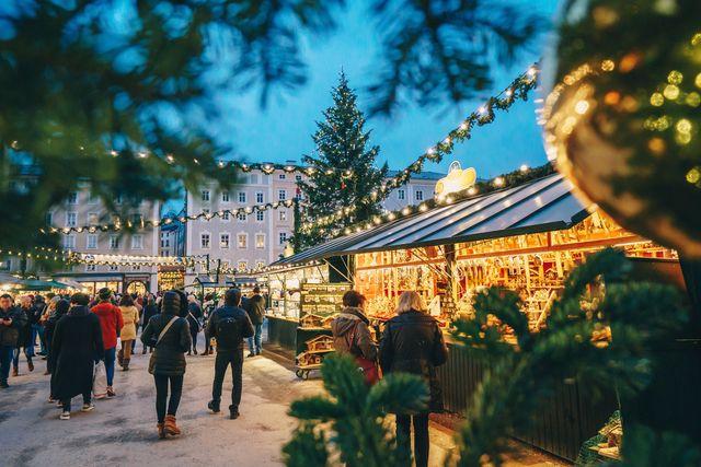 r0j3nt salzburg christmas market seen trough a christmas tree branches