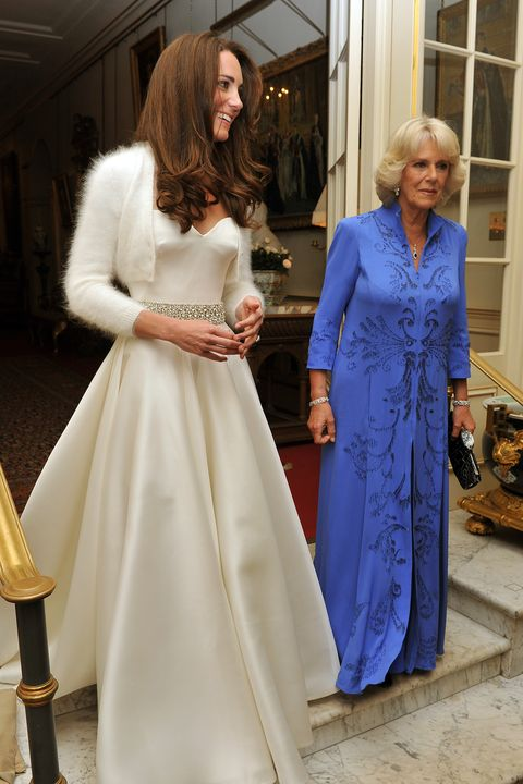 london, united kingdom   april 29  catherine, duchess of cambridge l and camilla, duchess of cornwall leave clarence house to travel to buckingham palace for the evening celebrations following her wedding to prince william, duke of cambridge on april 29, 2011 in london, england the marriage of the second in line to the british throne was led by the archbishop of canterbury and was attended by 1900 guests, including foreign royal family members and heads of state thousands of well wishers from around the world have also flocked to london to witness the spectacle and pageantry of the royal wedding  photo by john stillwell   wpa poolgetty images