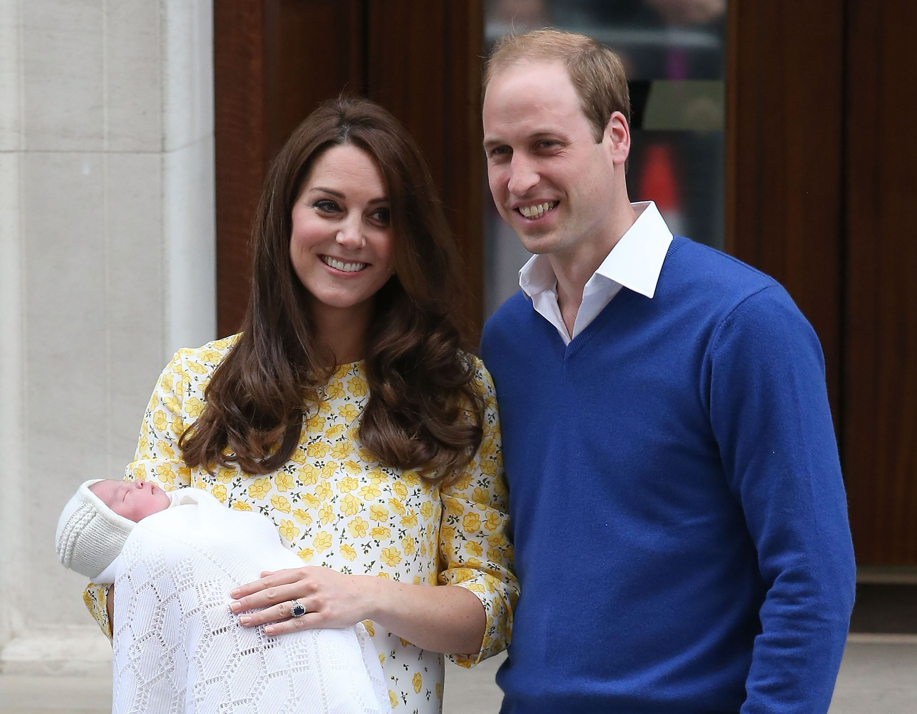 The Duke and Duchess of Cambridge pose for photos outside the Lindo Wing with Princess Charlotte.