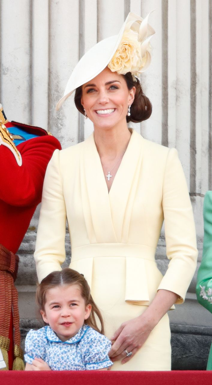 For t he annual Trooping the Colour parade, the Duchess chose a light yellow dress by Alexander McQueen , with a hat by Philip Treacy.