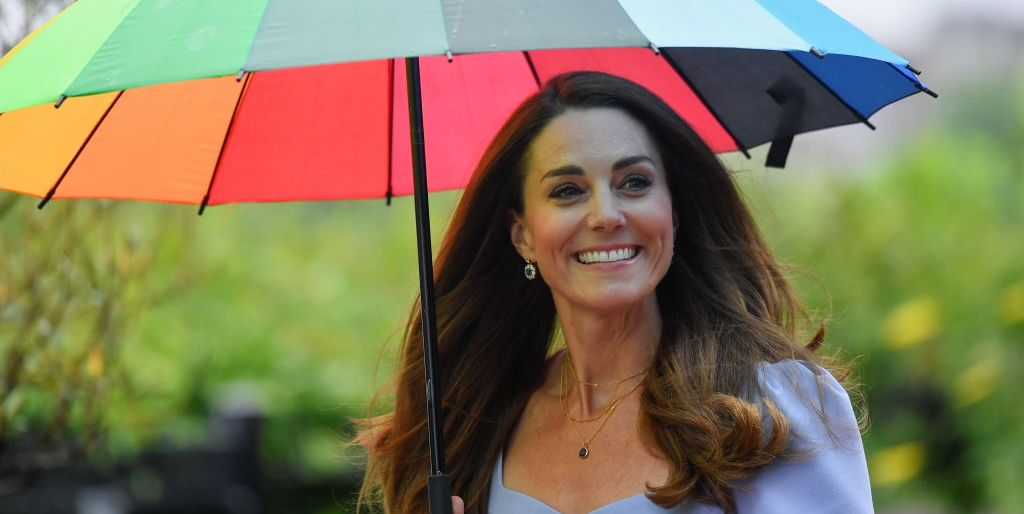 Kate Middleton Stepped Out in a Chic Lavender Midi Dress and Rainbow Umbrella For Early Childhood Event