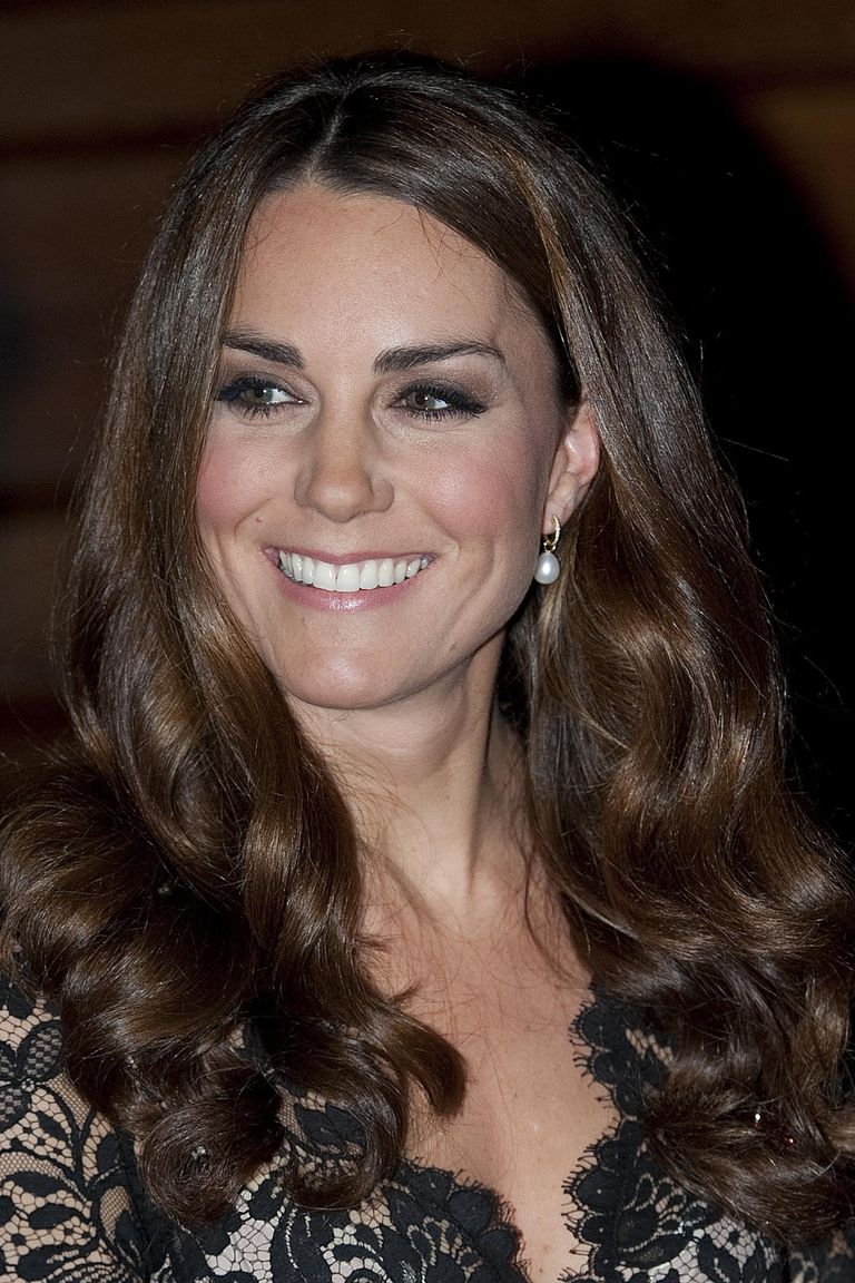 The Duchess glowed at a reception in London with voluminous curls and a middle part.