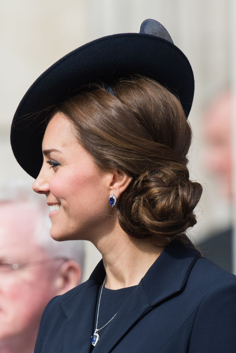 Kate stunned at a Service of Commemoration for soldiers in Afghanistan with a complicated side bun that looks almost like a flower.