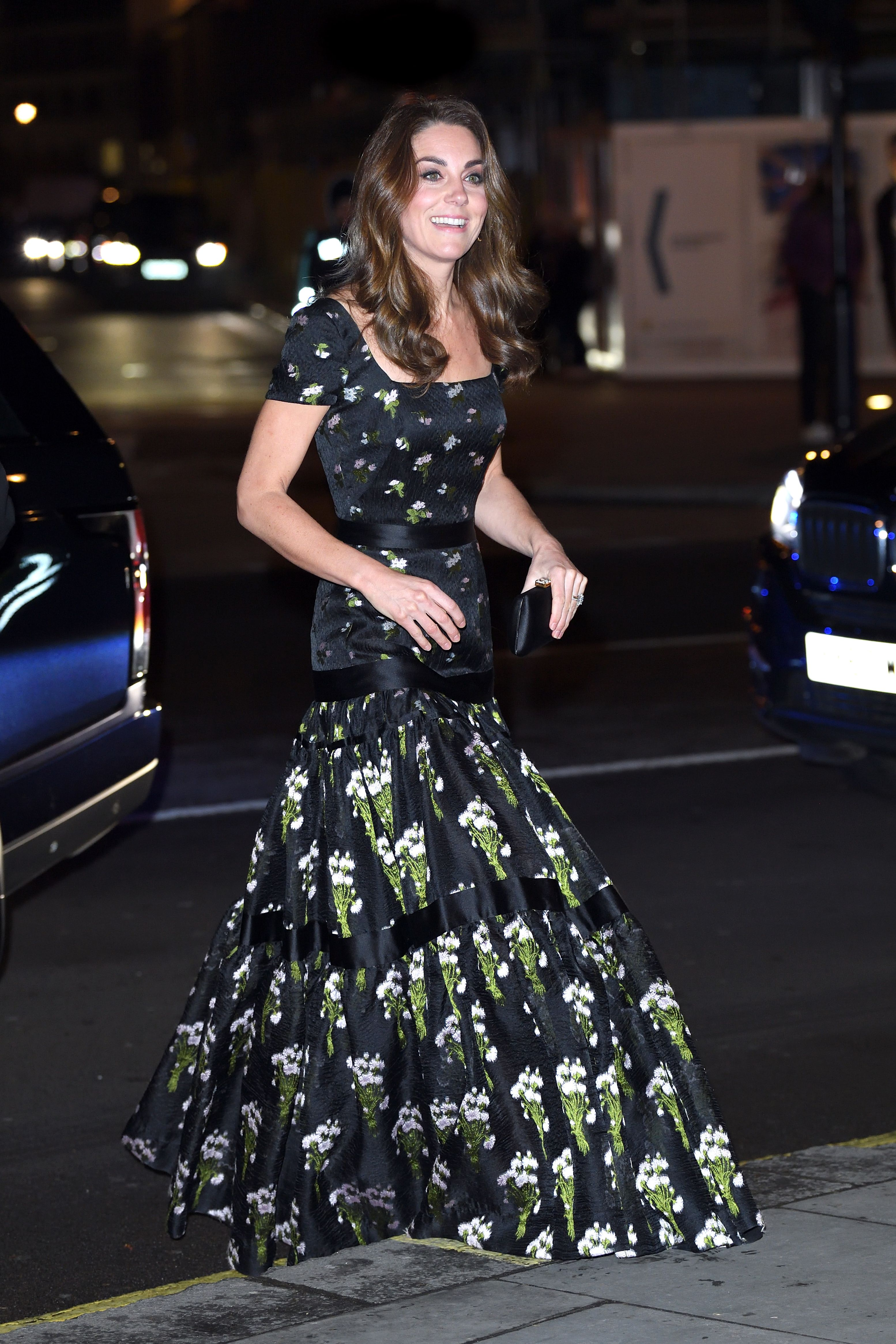 Kate Middleton attended the National Portrait Gallery Gala wearing a re-tailored Alexander McQueen dress, that she previously wore in 2017, Kiki McDonough earrings , and a Prada clutch.