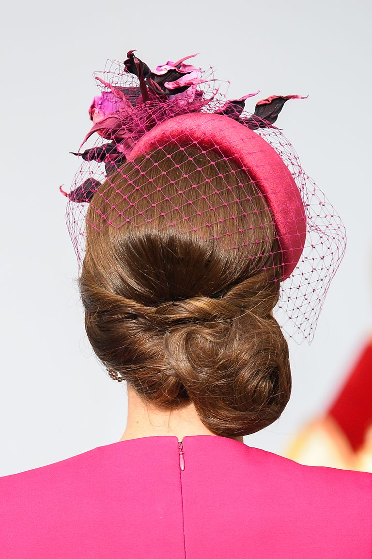 For Princess Eugenie's wedding, the Duchess twisted a few sections of her hair and pulled the rest to the right in a low chignon.