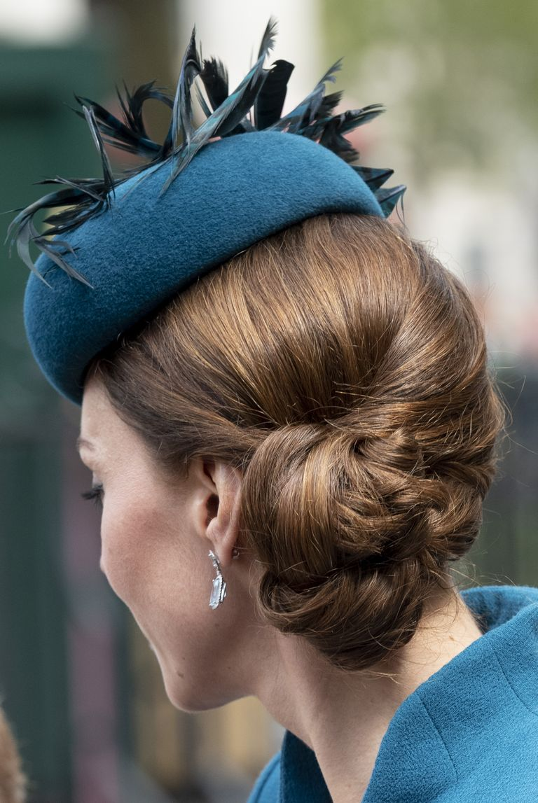 For this look, Duchess Kate twisted her hair to the left side, into a sophisticated pretzel bun.