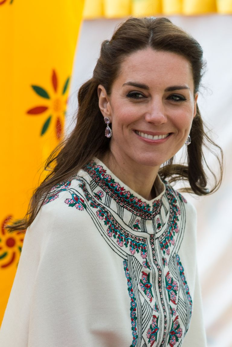 On a visit to Bhutan, the Duchess kept her hair out of her face by twisting the sides and pulling them into a small bun.