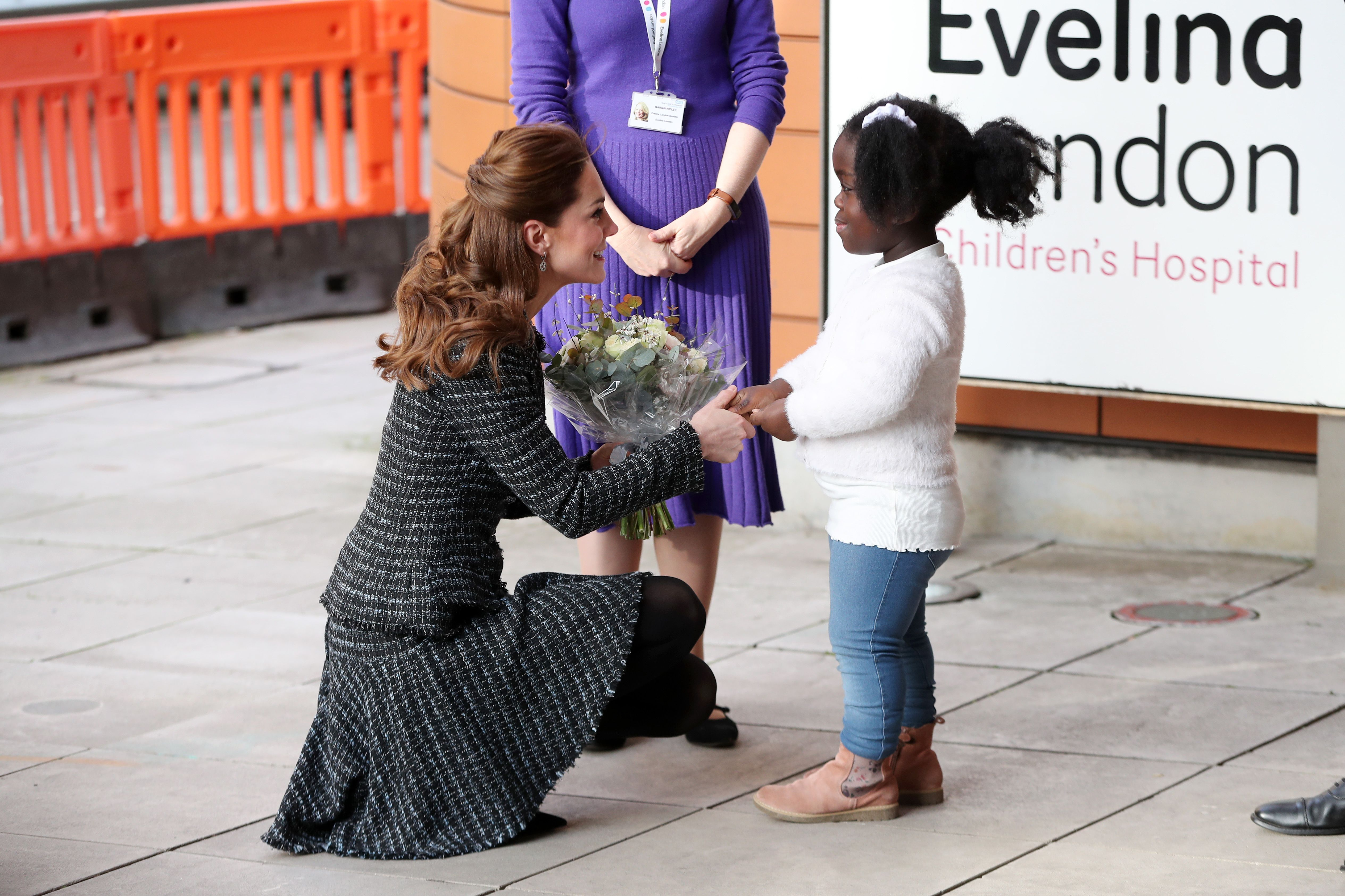 The Duchess of Cambridge steps out in tweed skirt suit for visit to a children's hospital
