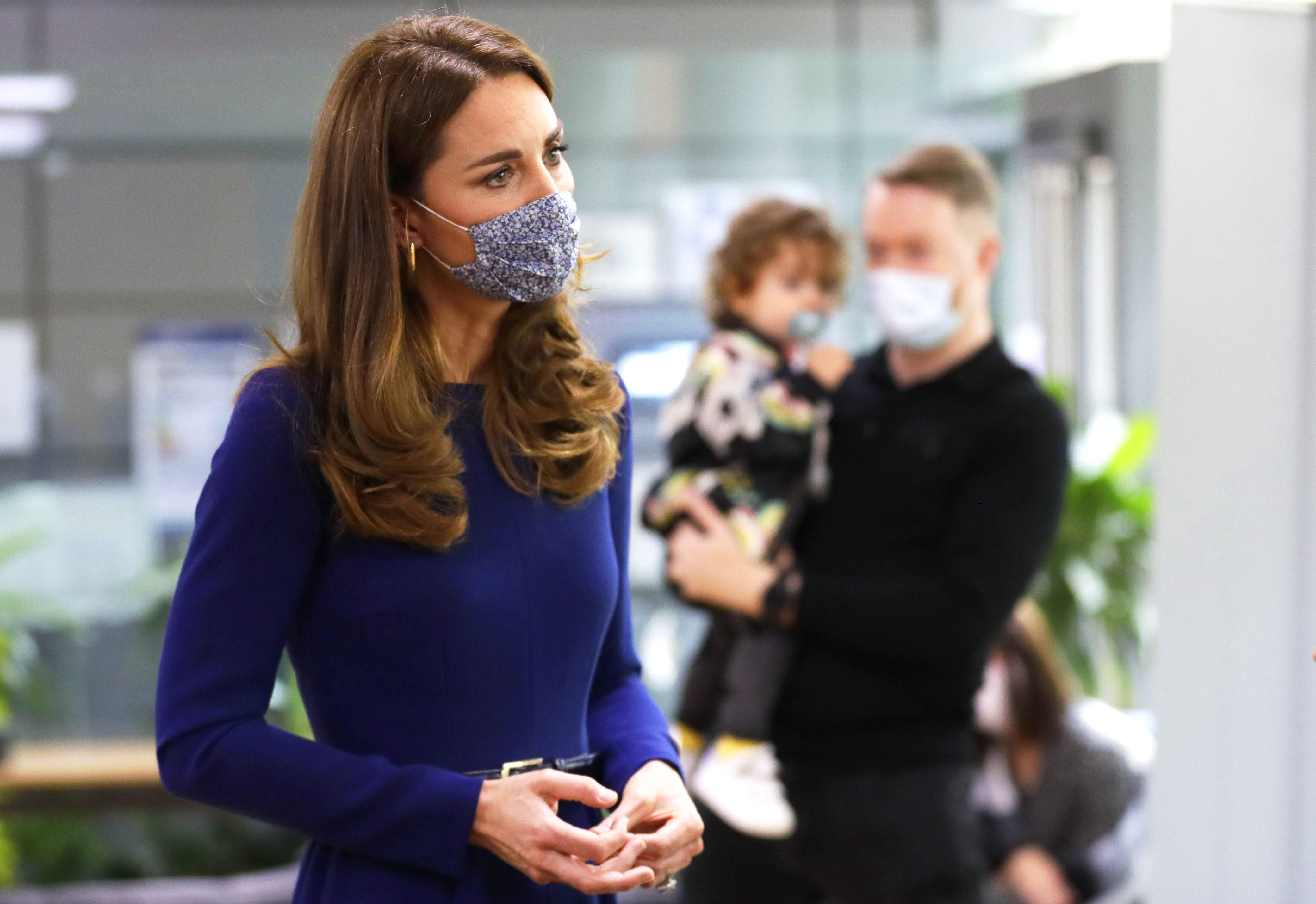 kate middleton matches her floral face mask to her blue dress her floral face mask to her blue dress