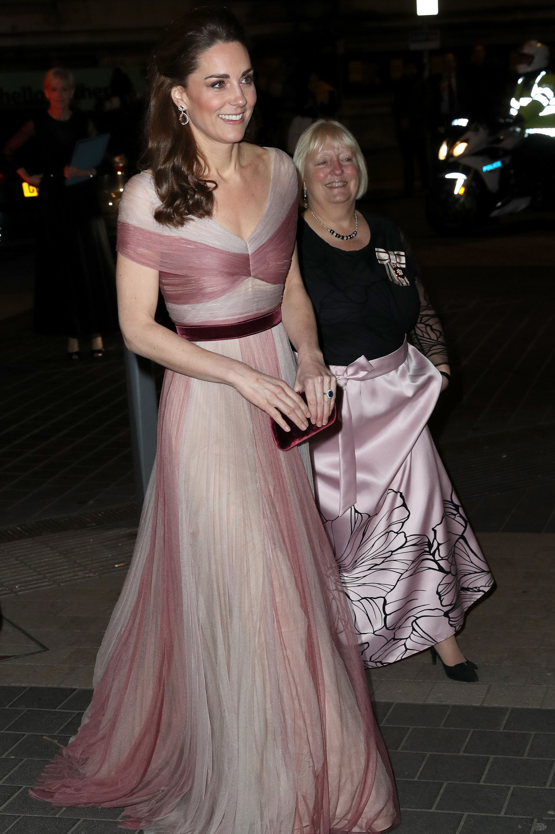 Kate Middleton arrived to the 100 Women in Finance Gala at the Victoria & Albert Museum wearing a rose-colored gown by Gucci. The duchess paired the look with a raspberry velvet clutch that matched her belt and pear-shaped drop earrings.