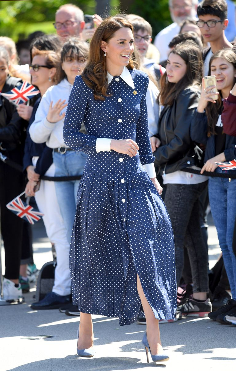 During a visit to Bletchley Park—the WWII-era facility where codebreakers, including Kate's grandmother, worked to decipher Axis messages— the Duchess rewore a navy polka-dot dress from Alessandra Rich . She accessorized the dress with a pin designed to look like a gear from the Enigma machine, a device made at Bletchley Park.