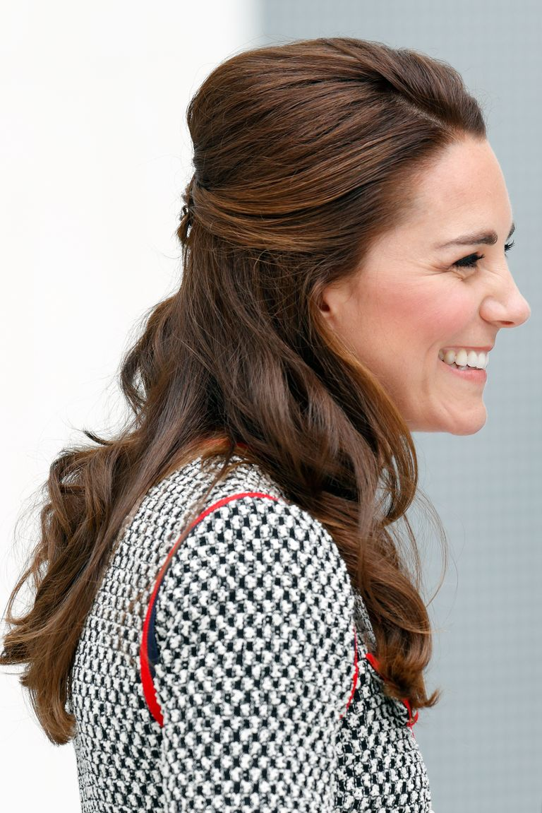 The Duchess added a classy twist to her usual half-up style, with loose curls and a small bouffant for extra volume.