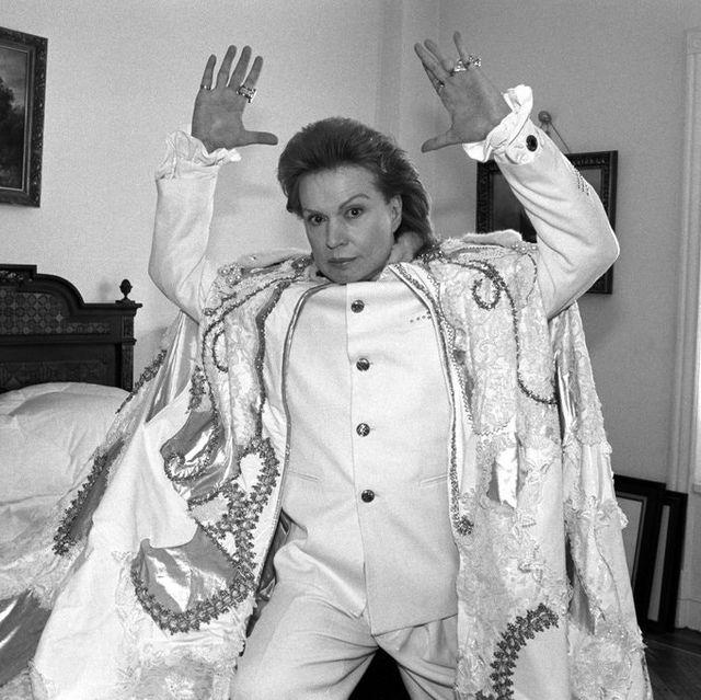 walter mercado, astrologer, white suit, androgyny, bedroom