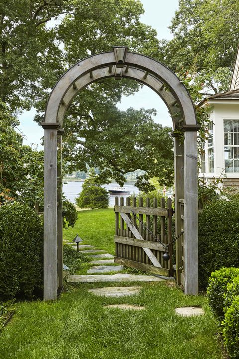 a wooden arch garden gate that leads to the connecticut river