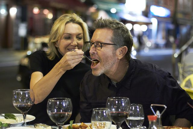 caucasian couple eating at urban cafe, new york city, new york, united states