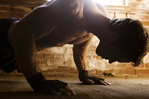 Caucasian man doing push-ups