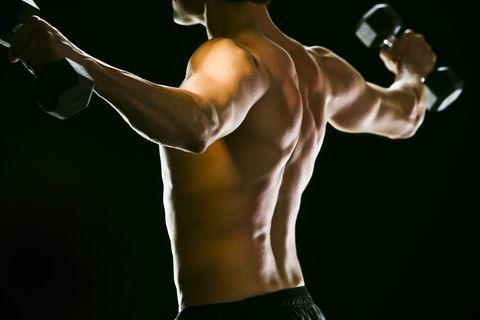 Caucasian man exercising with dumbbells