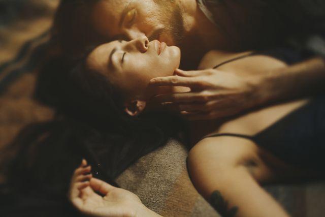 caucasian man kissing woman on cheek
