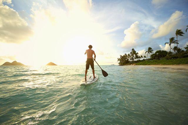 caucasian man on paddle board in ocean