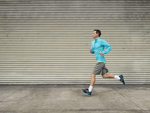caucasian man running on city street