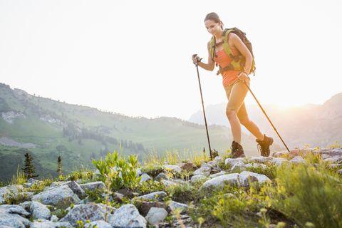 Caucasian woman hiking on rocky trail