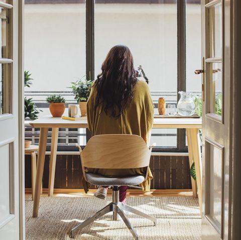 caucasian woman sitting at desk