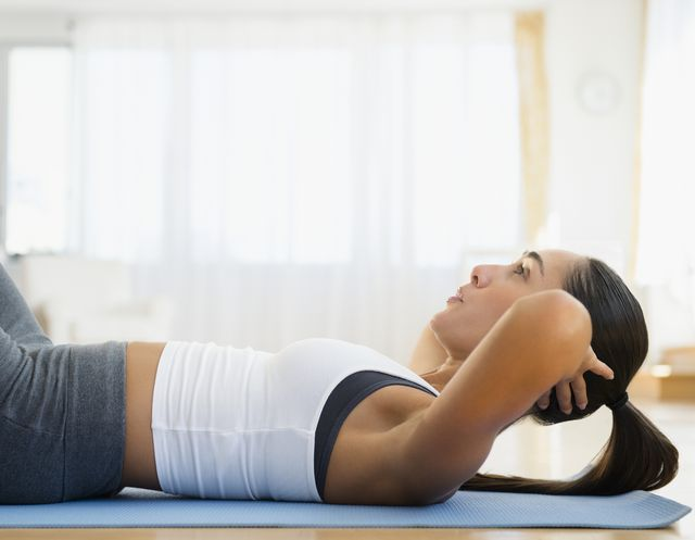 caucasian woman working out on exercise mat