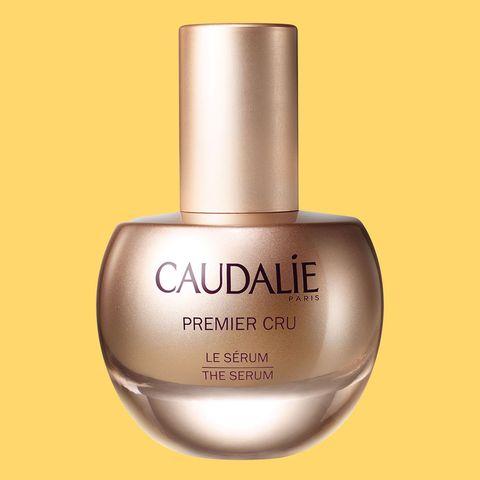Liquid, Fluid, Brown, Perfume, Lavender, Cosmetics, Bottle, Peach, Beige, Material property,