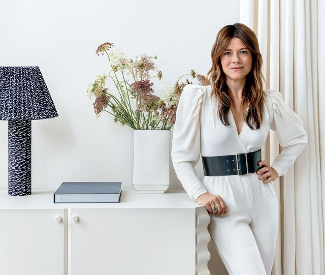 designer kara mann poses with her new cb2 collection
