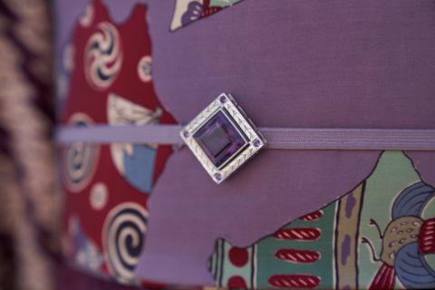 池田由紀子さんの帯