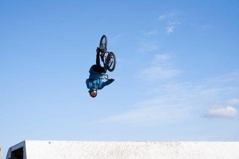 Extreme sport, Stunt, Stunt performer, Freestyle bmx, Vehicle, Bmx bike, Bicycle motocross, Sports, Flip (acrobatic), Recreation,