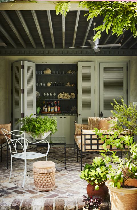 poolside drinks are served from a glazed tile bar behind folding louvered doors